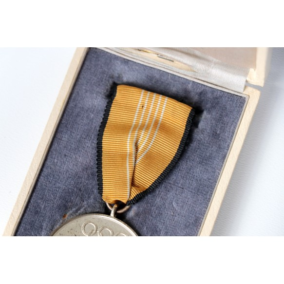 Olympia medal + box