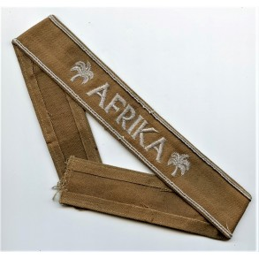 Afrika cuff title, brown canvas variant