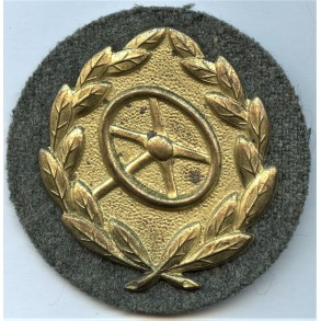 Driver's proficiency badge in gold
