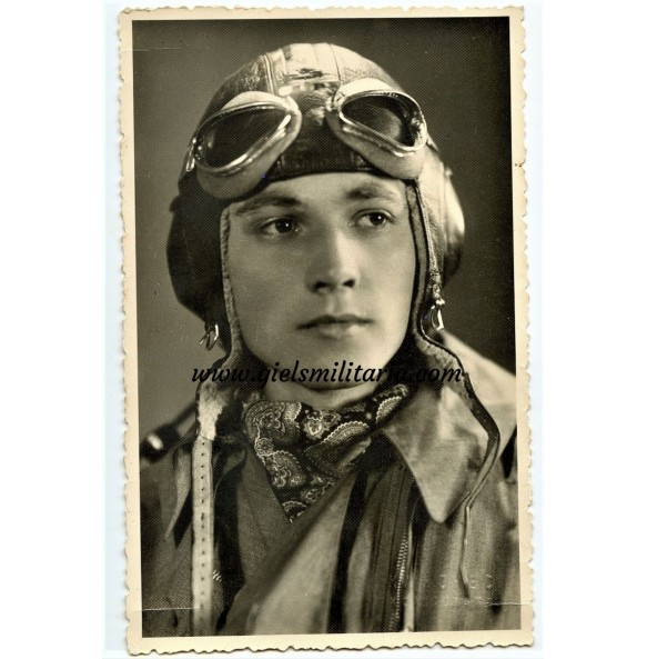 Portrait pilot in flight gear with scarf