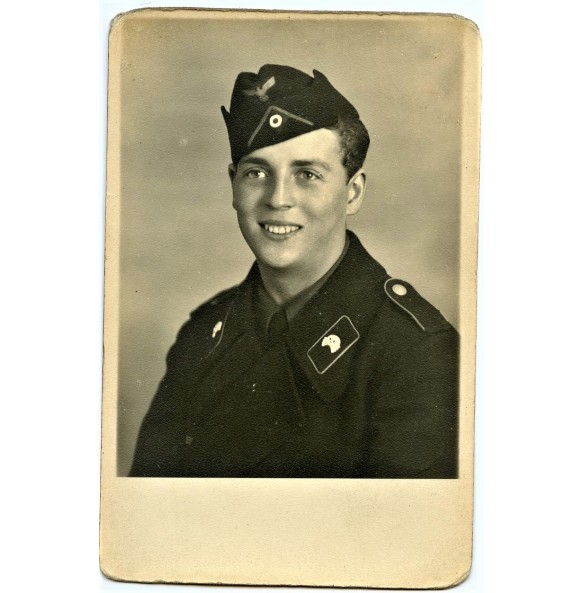 Portrait panzer crew member in black wrapper with side cap