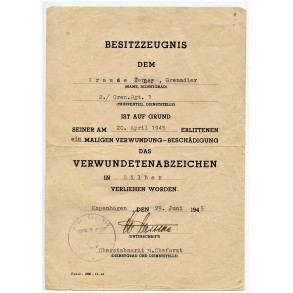 Award document to W. Kraude, member of Gren. Reg 1, WIA Pillau April 1945