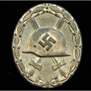 """Wound badge in silver by Carl Wild """"107"""""""