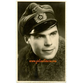 Portrait photo officer with crusher cap and fur coat