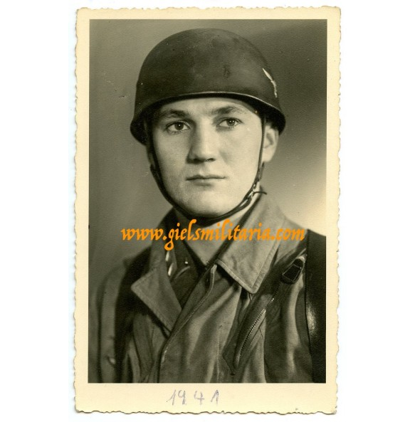 Portrait paratrooper with jump helmet in wear
