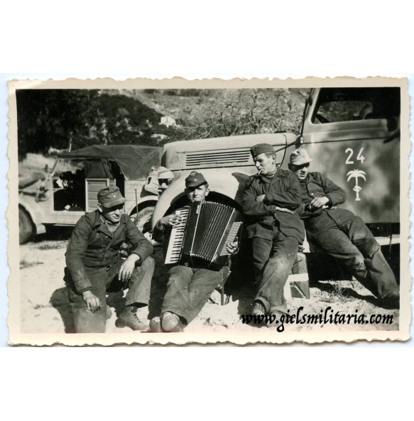 Private snapshot Afrikakorps with camoflaged Opel Blitz