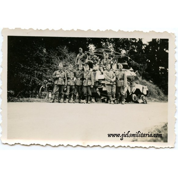 Private snapshot of army unit in front of Panzerspähwagen
