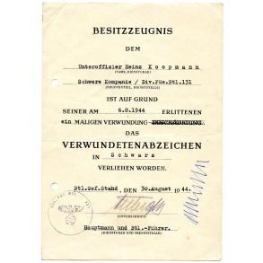 Wound badge in black award document to Uffz H. Koopmann Füs. Btl 131, 1944