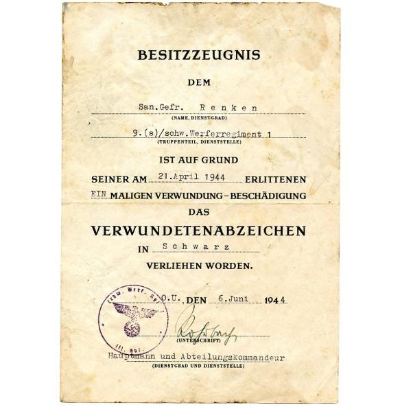 Wound badge in black award document to San. Gefr. Renken, sch. Werferregiment 1!