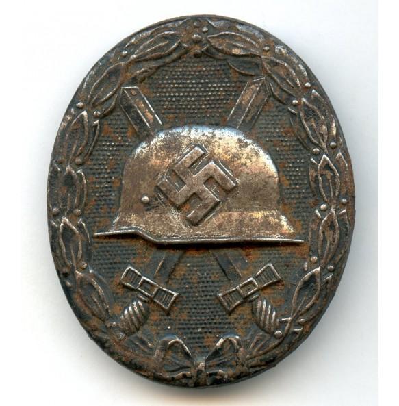 """Wound badge in black by Deschler & Sohn """"L/10"""""""