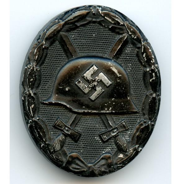 "Wound badge in black by E. Schmidthaussler ""ES.P."""