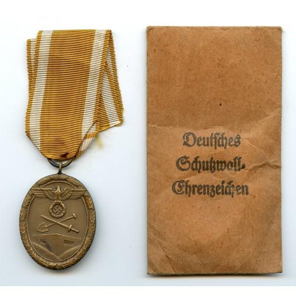 Westwall medal by W. Redo + package