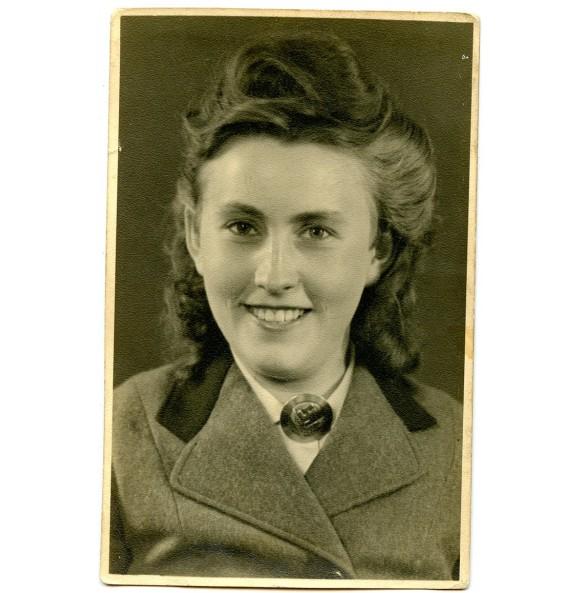 Portrait photo female RAD member with RAD broach
