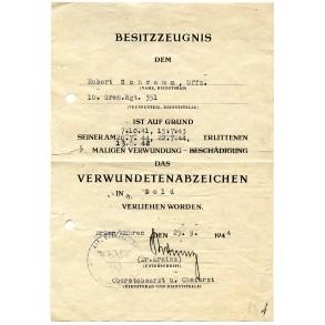 Wound badge in GOLD award document to Uffz. H. Schramm, GR351