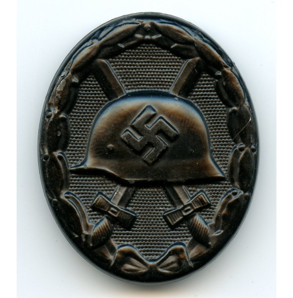 """Wound badge in black by Carl Wild """"107"""""""