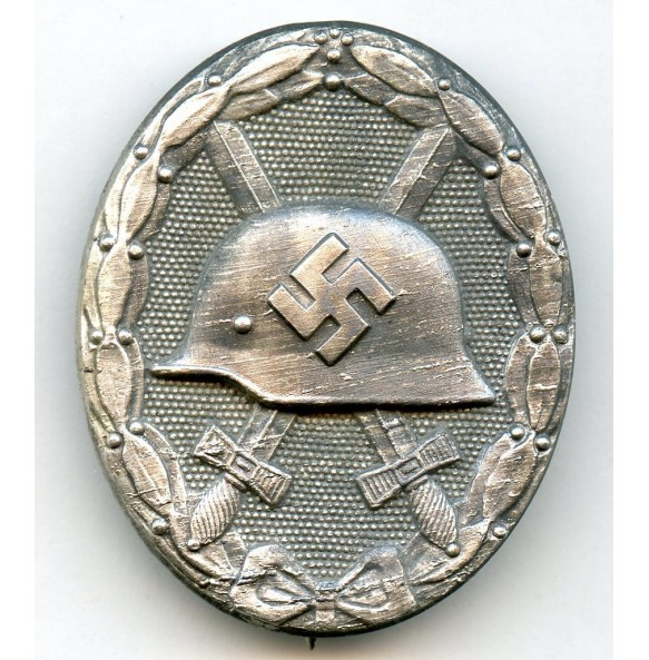 "Wound badge in silver by Moritz Hausch A.G. ""127"""