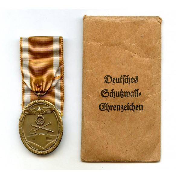Westwall medal by Karl Hensler + package