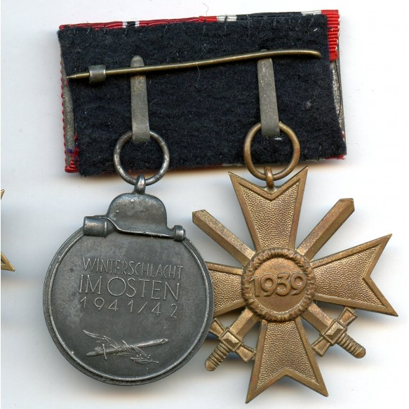 2 place medal bar with war merit cross and east front medal