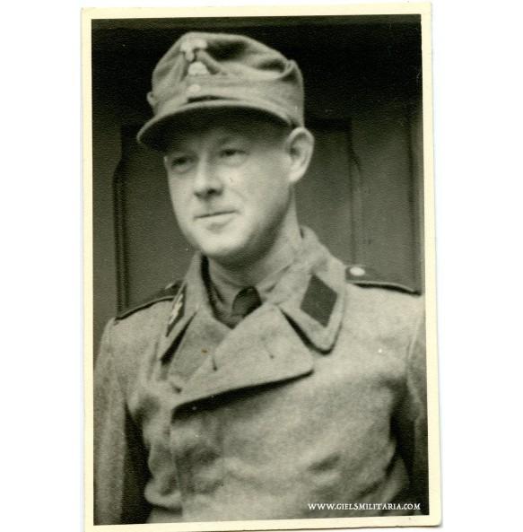Private photo SS Sturmgeschütz member in green wrapper.