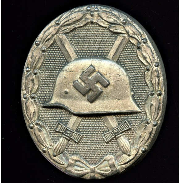 "Wound badge in silver by Klein & Quenzer A.G ""65"""
