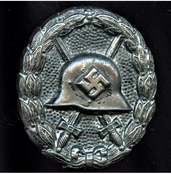 Wound badge in black, 1st pattern variant STEEL