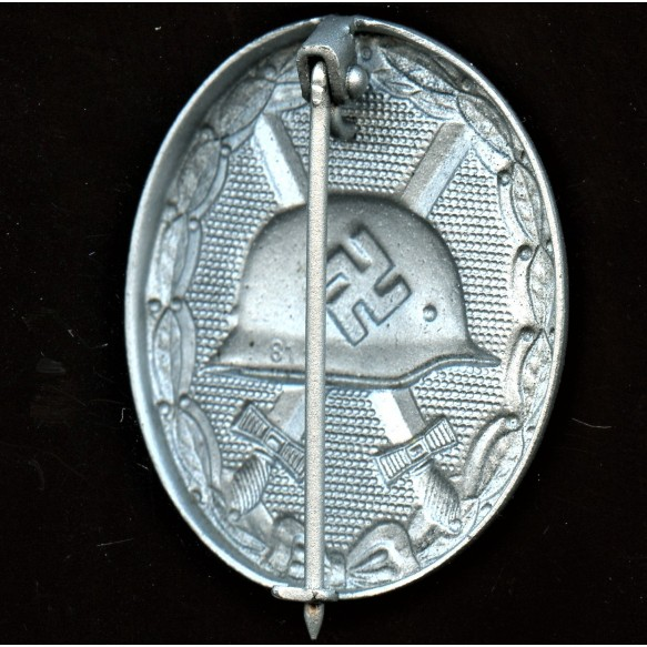 """Wound badge in silver by Oberhoff & Cie """"81"""""""
