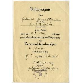Wound Badge in Black award document to Feldwebel H. Lüstmann