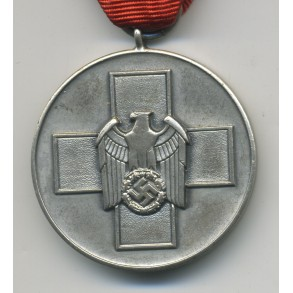 Social welfare medal + package by Gebr. Godet & Co